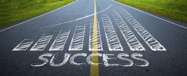 success-graph-drawn-on-road